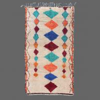 Vintage Azilal rug decorated with traditional Berber symbols to give good luck