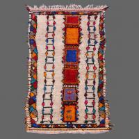 A vintage Azilal carpet in a myriad of colors in relaxed style